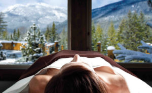 Woman massage table mountainside view