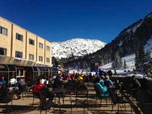 The patio with skiers on a beautiful alta day